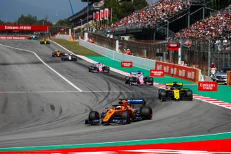 Carlos Sainz Jr., McLaren MCL34, leads Daniel Ricciardo, Renault R.S.19, Sergio Perez, Racing Point RP19, and Lance Stroll, Racing Point RP19