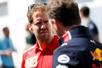 Sebastian Vettel, Ferrari and Christian Horner, Team Principal, Red Bull Racing