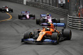 Lando Norris, McLaren MCL34, leads Lance Stroll, Racing Point RP19, and Sergio Perez, Racing Point RP19