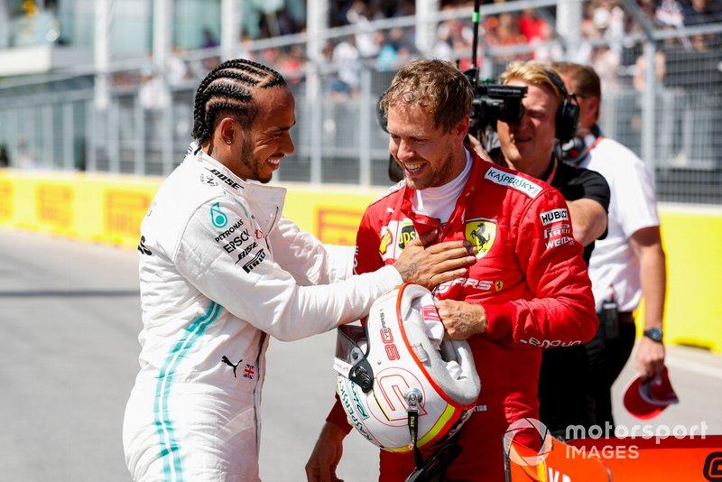 Sebastian Vettel, Ferrari Pole sitter and Lewis Hamilton, Mercedes AMG F1 celebrate in Parc Ferme