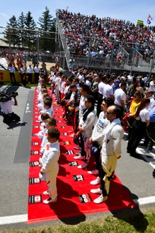 The drivers line up for the national anthem prior to the start