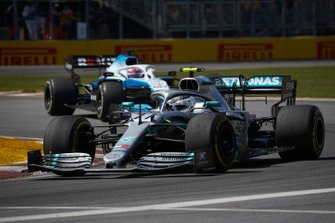 Valtteri Bottas, Mercedes AMG W10, leads George Russell, Williams Racing FW42