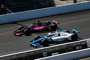 Helio Castroneves, Meyer Shank Racing Honda and Alex Palou, Chip Ganassi Racing Honda battle for the lead