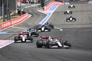 Antonio Giovinazzi, Alfa Romeo Racing C41, Kimi Raikkonen, Alfa Romeo Racing C41, and Lance Stroll, Aston Martin AMR21