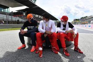 Max Verstappen, Red Bull Racing, Carlos Sainz Jr., Ferrari, and Charles Leclerc, Ferrari