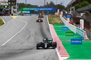 Lewis Hamilton, Mercedes W12, Charles Leclerc, Ferrari SF21, and Valtteri Bottas, Mercedes W12