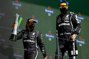 Lewis Hamilton, Mercedes, 1st position, and Valtteri Bottas, Mercedes, 3rd position, on the podium