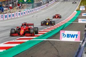 Charles Leclerc, Ferrari SF21, Sergio Perez, Red Bull Racing RB16B, and Carlos Sainz Jr., Ferrari SF21