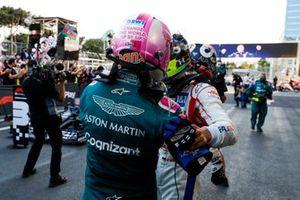Sebastian Vettel, Aston Martin, 2nd position, is congratulated by Mick Schumacher, Haas F1, in Parc Ferme