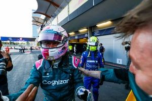 Sebastian Vettel, Aston Martin, 2nd position, celebrates with his team in Parc Ferme