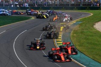 Sebastian Vettel, Ferrari SF90, leads Charles Leclerc, Ferrari SF90, Max Verstappen, Red Bull Racing RB15, Kevin Magnussen, Haas F1 Team VF-19, Nico Hulkenberg, Renault F1 Team R.S. 19, Romain Grosjean, Haas F1 Team VF-19, and the remainder of the field at the start