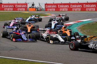 Romain Grosjean, Haas F1 Team VF-19, leads Kimi Raikkonen, Alfa Romeo Racing C38, Daniil Kvyat, Toro Rosso STR14, Lando Norris, McLaren MCL34, Carlos Sainz Jr., McLaren MCL34, George Russell, Williams Racing FW42, and the remainder of the field at the start