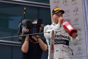 Valtteri Bottas, Mercedes AMG F1, 2nd position, drinks Champagne on the podium