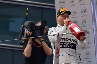 Valtteri Bottas, Mercedes AMG F1, 2nd position, drinks Champagne on the podium