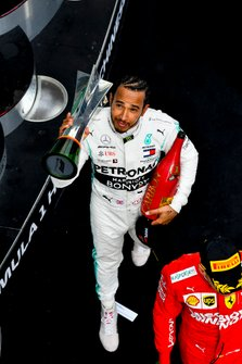 Lewis Hamilton, Mercedes AMG F1 celebrates on the podium with the trophy and the champagne