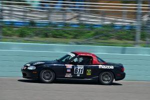 #611 MP4B Mazda Miata driven by Gregory Gilot of FAAS Racing