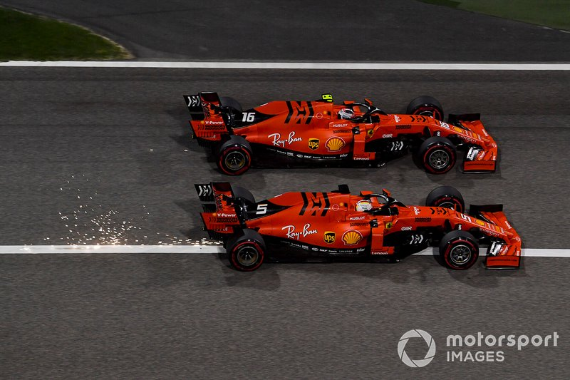 Charles Leclerc, Ferrari SF90 overtakes Sebastian Vettel, Ferrari SF90 for the lead