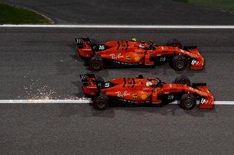 Charles Leclerc, Ferrari SF90 overtakes Sebastian Vettel, Ferrari SF90 for the lead