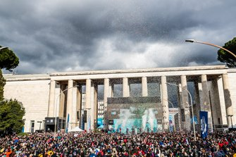 Confetti flies above the podium
