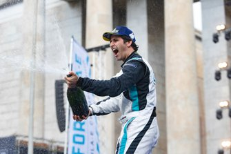 Sérgio Jimenez, 1st position, sprays champagne on the podium