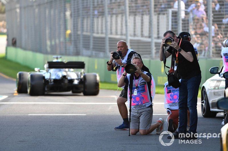 Photographers take aim in the pit lane