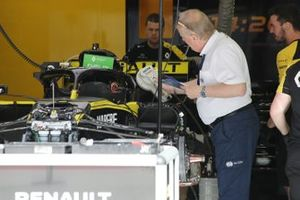 FIA delegate Jo Bauer uses a device to scan multiple chips that can be used to acquire data about the Renault F1 Team chassis