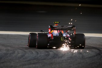 Sparks fly from the rear of Pierre Gasly, Red Bull Racing RB15