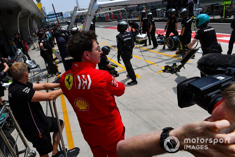 Mattia Binotto, Team Principal Ferrari, watches as Mercedes make a pit stop during practice with Valtteri Bottas, Mercedes AMG W10