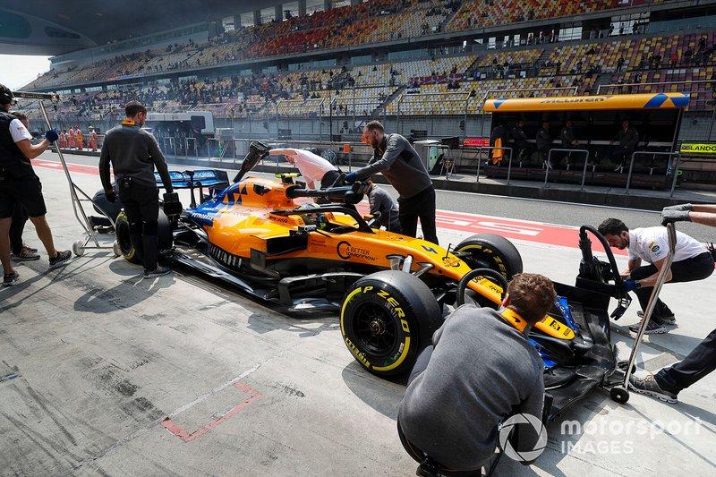 Lando Norris, McLaren MCL34, in pit lane