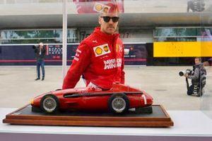 Sebastian Vettel, Ferrari, admires a model Maserati 250F