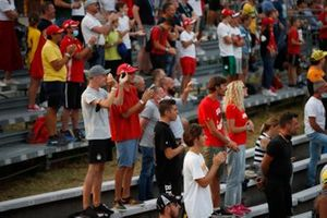 Fans applaud from a grandstand
