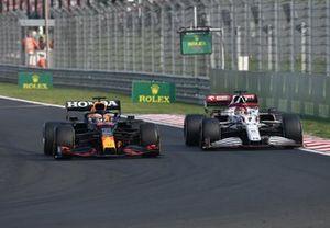 Max Verstappen, Red Bull Racing RB16B, passes Kimi Raikkonen, Alfa Romeo Racing C41