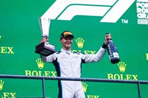 George Russell, Williams, 2nd position, with his trophy and Champagne