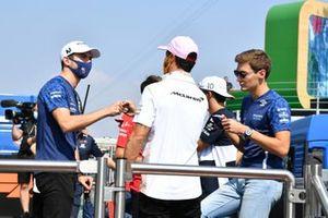Nicholas Latifi, Williams, Daniel Ricciardo, McLaren, and George Russell, Williams, in the drivers parade