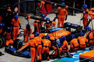 Lando Norris, McLaren MCL35M, makes a pit stop