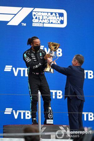 Lewis Hamilton, Mercedes, 1st position, receives his trophy
