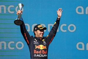 Sergio Perez, Red Bull Racing, 3rd position, lifts his trophy