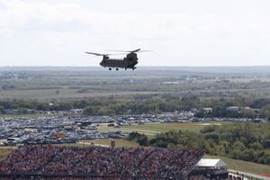 A CH-47D Chinook of the US Army forms part of the pre race fly past