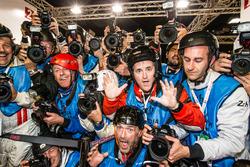 Photographers scrum for the pole celebration as shot by Romain Dumas