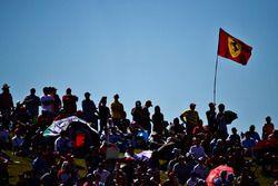 Fans and a Ferrari flag