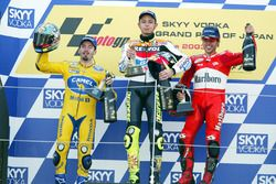 Podium: winner Valentino Rossi, Repsol Honda Team, second place Max Biaggi, Pramac Pons, third place