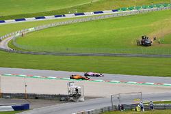 Stoffel Vandoorne, McLaren MCL33 and Esteban Ocon, Force India VJM11