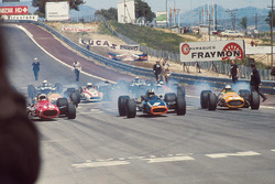 Poleman Chris Amon, Ferrari 312 is left behind by Pedro Rodriguez, BRM P133 and Denny Hulme, McLaren