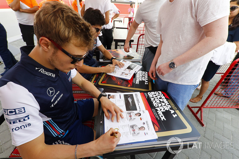 Lance Stroll, Williams Racing, and Sergey Sirotkin, Williams Racing, sign autographs for fans