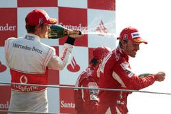 Podium: Jenson Button, McLaren MP4-25 Mercedes, 2nd position, Fernando Alonso, Ferrari F10, 1st posi