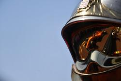 Fernando Alonso, McLaren MCL33 reflected in a fireman helmet