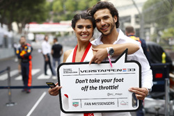 Models display messages from fans on the grid