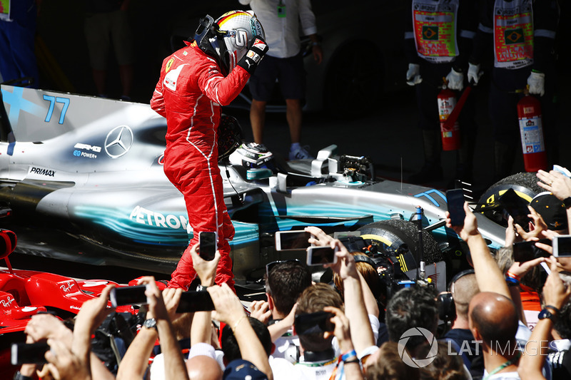 Sebastian Vettel, Ferrari SF70H, celebrates as he climbs from his car after winning the race