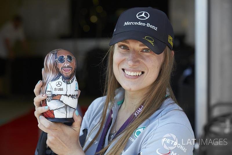 A Mercedes fan holds a Lewis Hamilton matryoshka figurine doll