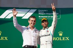 The Mercedes Constructors trophy delegate and Lewis Hamilton, Mercedes AMG F1, 1st position, on the podium